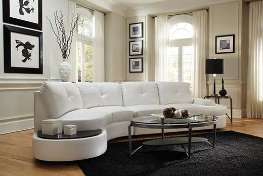 1. Contemporary Sectional Sofa with Built-In Table is...